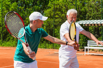 Tennis class with older man
