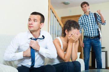 Man seeing girlfriend cheating on him.