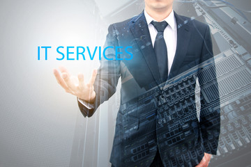 Double exposure of business man with servers technology in data center in IT services business concept