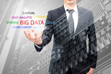 Double exposure of businessman holding big data information and server storage in data center, IT Business concept