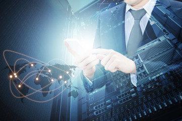 Double exposure of professional businessman using smart phone with servers technology in data center and world map network connection in IT Business concept, world map from NASA