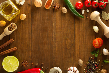 herbs and spices on wood background