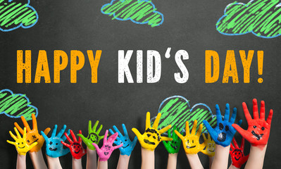 "painted kids hands with the message ""Happy Kid's Day!"""