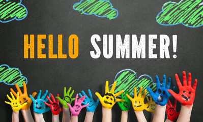 "painted kids hands with chalk message ""Hello Summer!"""