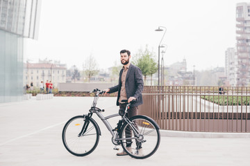 young casual bearded businessman with bike