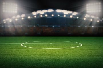 empty football field with stadium at night