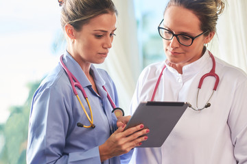 Young brazilian doctor and nurse with tablet