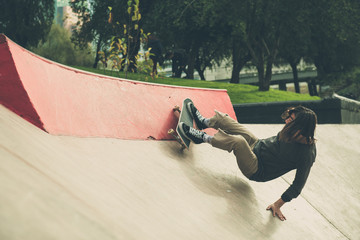 Skate boarder doing tricks at skate park