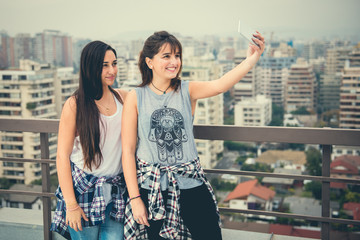 Modern Girlfriends in the city using a smart phone