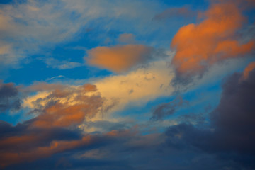 Sunset orange clouds in a blue sky