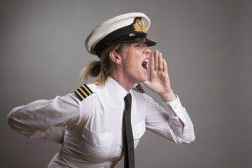 OFFICER SHOUTS AN ORDER MAY 2016 - Portrait of a female uniformed officer shouting and order