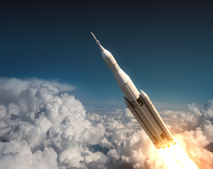Fototapete - Space Launch System Flying In The Clouds