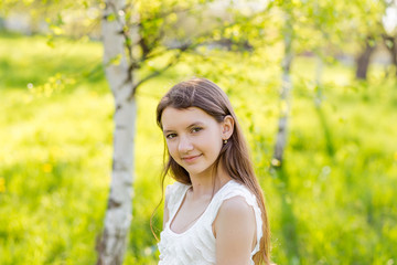 portrait of happy girl on nature in summer