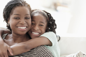 Black mother and daughter hugging