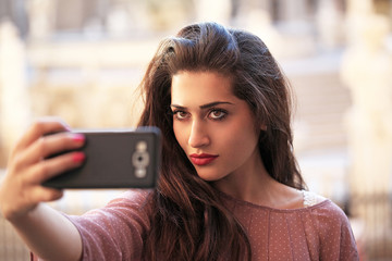 Beautiful girl taken pictures of her self. Selfie