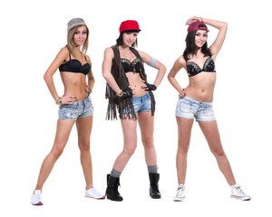 three cool girls posing in sexy jeans shorts. Isolated on white
