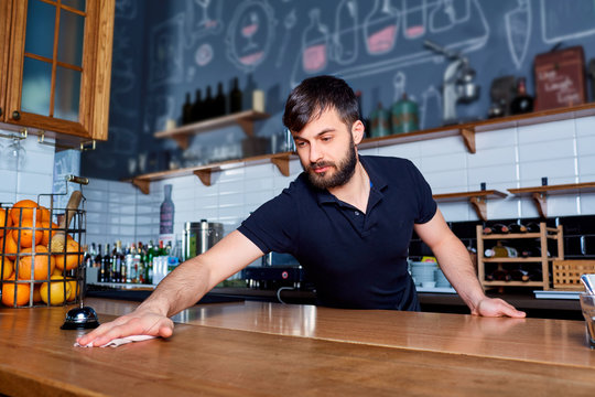 Bartender wiping down bar counter