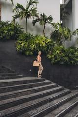 Caucasian woman walking on stairs