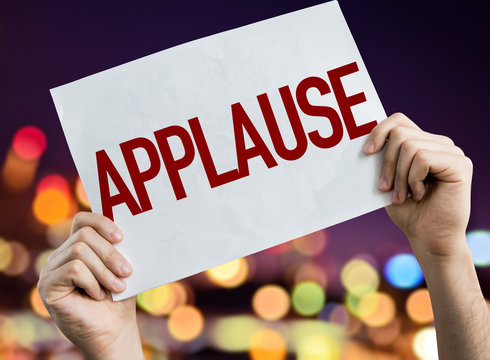 Applause placard with night lights on background