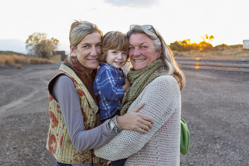 Caucasian mother, son and grandmother smiling outdoors