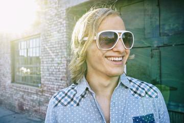 Caucasian man smiling outdoors