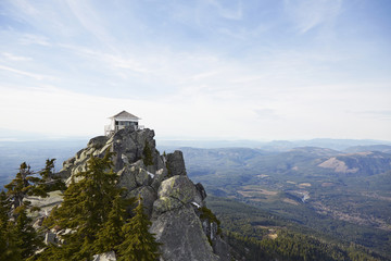 View of Mt Pilchuck fire lookout tower on top of rocky mountain