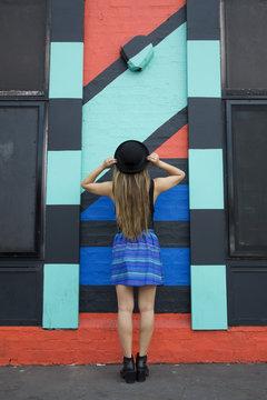 Asian woman admiring painted wall