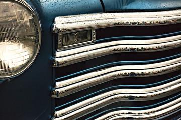 Class blue car grill detail.