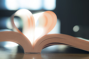 Soft heart paper book page. Vintage color of sunlight. Valentine, Love, Wedding..