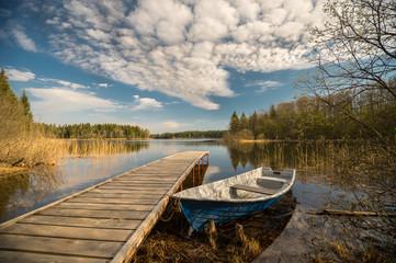 Printed kitchen splashbacks Lake Old wooden pier and boat on the lake