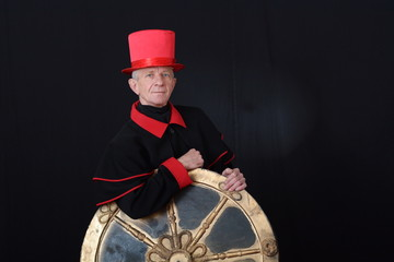 Actor in a red hat holding a wheel