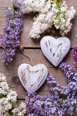 Fresh aromatic lilac flowers  and two decorative hearts