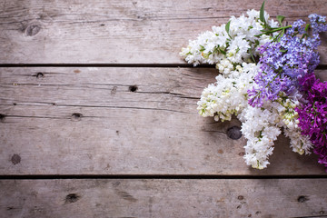 Fresh aromatic lilac flowers on vintage wooden planks.