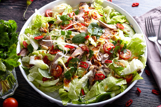 Asian beef salad with cucumber, lettuce and chilli