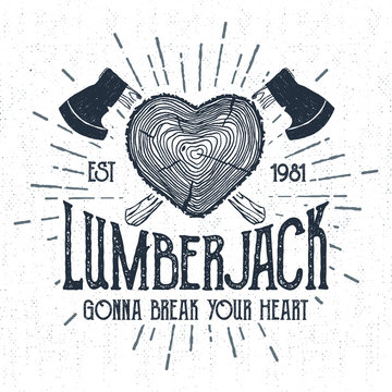 """Hand drawn label with textured log vector illustration and """"Lumberjack. Gonna break your heart"""" lettering."""