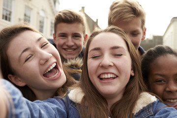 Teenagers Taking Selfie On Mobile Phone In Urban Setting