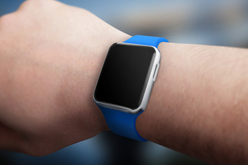 Smart watch on hand with blank screen for mockup.