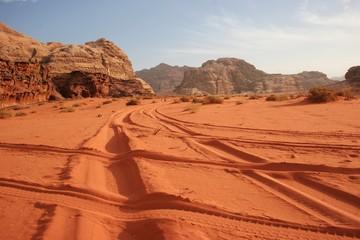 Wadi Rum desert red sand with vehicle tracks