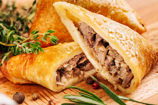 Delicious samosa pies with meat on plate. Menu, restaurant, reci