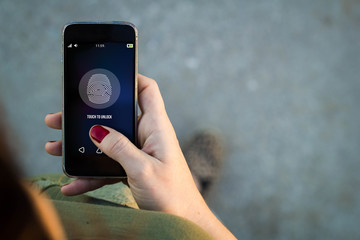 Woman walking smartphone fingerprint