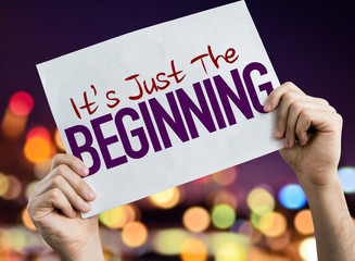 Its Just the Beginning placard with night lights on background