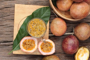 Passion fruit smoothie is delicious on wood background.