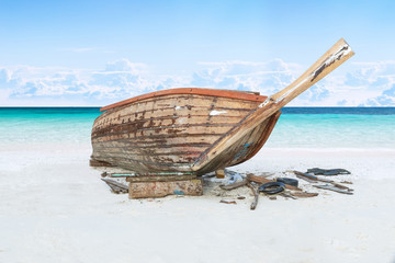 assemble fishing boat on sand with blue sky and sea