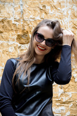 portrait of model posing outdoors in black leather clothes