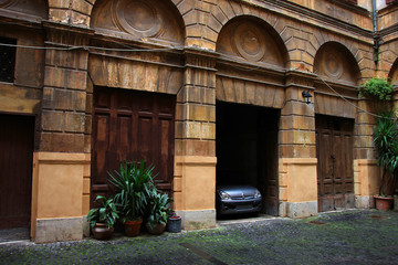 unusual interesting old medieval private car garages in the ital