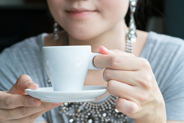 Young woman having coffee break