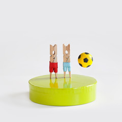 Soccer championship concept poster. Two football players, abstract clothespin characters. gray background, copy space
