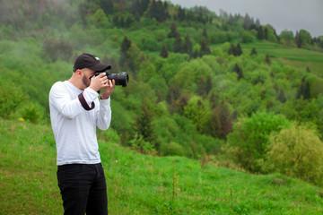 photographer takes mountain landscape