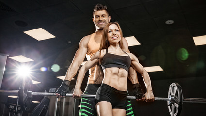Wall Mural - athletic couple poses for the camera