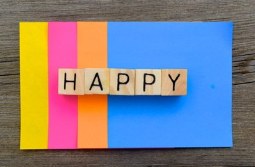 "Happy Concept - The Word ""Happy"" with a colorful vibrant background."